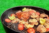 stock photo of baby back ribs  - Meat And Vegetables Mix On The Hot BBQ Charcoal Grill - JPG