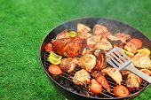 picture of roasted pork  - Assorted BBQ Roasted Pork And Chicken Meat With Vegetables On The Hot Charcoal Grill With Smoke - JPG