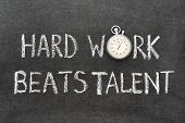 pic of beats  - hard work beats talent phrase handwritten on chalkboard with vintage precise stopwatch used instead of O - JPG