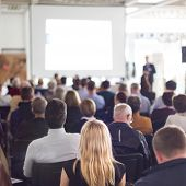 stock photo of audience  - Speaker Giving a Talk at Business Meeting - JPG
