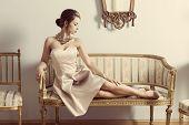 picture of aristocrat  - interior portrait of brunette elegant girl lying on retro sofa in aristocratic room - JPG