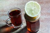 stock photo of cough  - Black tea with lemon and honey best for cough - JPG