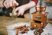 picture of cinnamon sticks  - Wooden coffee grinder with coffee beans - JPG