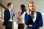 picture of people talking phone  - Business people in lobby - JPG