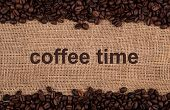 stock photo of peppy  - roasted coffee beans on a bag background - JPG