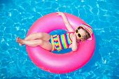 stock photo of girl toy  - Child in swimming pool - JPG