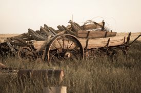 pic of wagon  - An abandoned historic wagon sits in a field