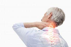 foto of spine  - Digital composite of Highlighted spine pain of man - JPG