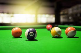 picture of pool ball  - Billiard Balls. A Vintage style photo from a billiard balls in a pool table. Noise added for a film effect