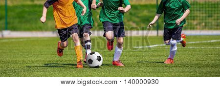 Boys playing soccer game. Horizontal sports football background.