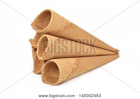 some waffle cones for ice cream on a white background
