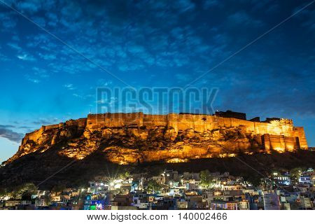 Blue city and Mehrangarh fort on the hill at night in Jodhpur, Rajasthan, India