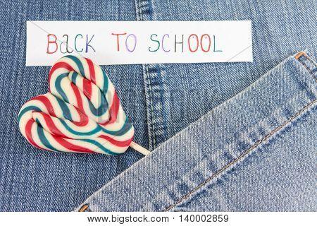 Lollipop in a denim blue jeans pocket