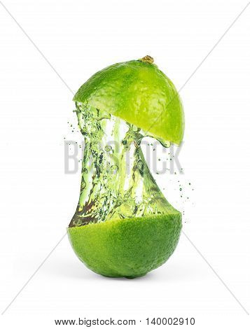Lime cut into two pieces with the juice in the center on a white background