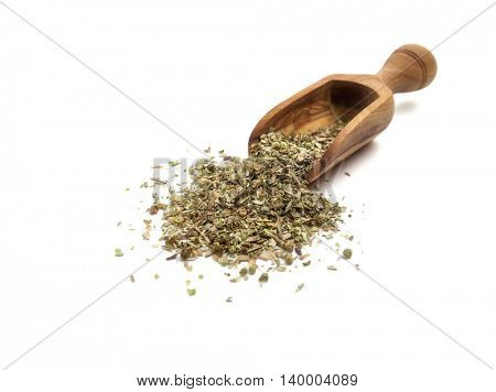 Dried oregano in a wooden spoon