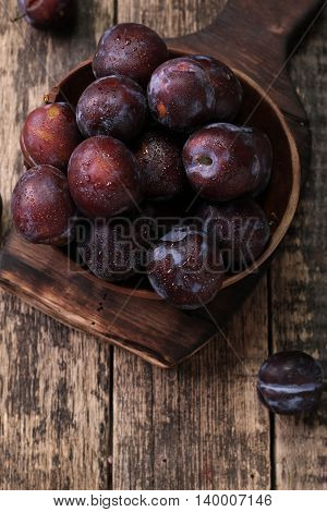 Ripe Plums On Wooden Vintage Background