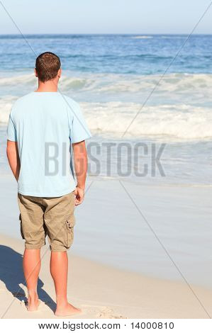 Handsome Man Walking On The Beach