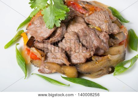 Mixed meat and mushroom salad served on a white plate