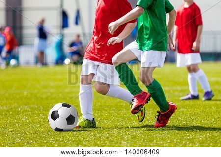 Football soccer game. Players footballers running and playing football match