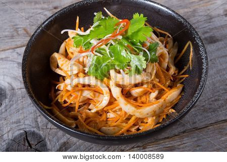 Spicy squid salad served in a bowl