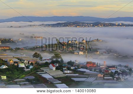Part of Dalat city in Central highland of Vietnam on morning mist