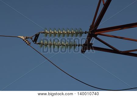 In wood a high-voltage line.Interesting - as insulators are arranged.