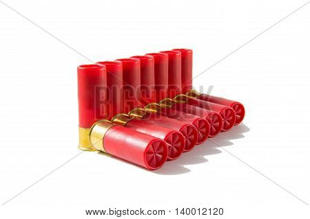 Red bullet shell of shotgun isolated on white background.