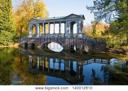 SAINT PETERSBURG, RUSSIA - OCTOBER 02, 2014: Marble bridge, golden autumn. Historical landmark of the Catherine Park of Tsarskoye Selo