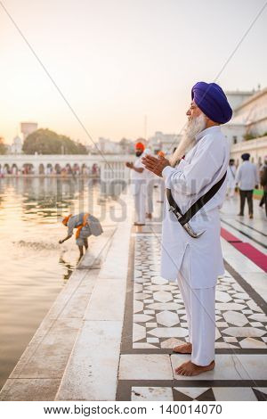 Amritsar, India - March 30, 2016: Unidentified sikh man praying near Golden temple in Amritsar