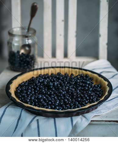 ready for baking blueberry pie. Fresh summer concept
