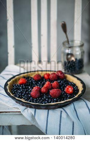 Berry pie ready for baking. Fresh summer concept