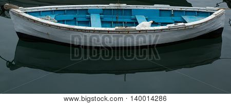Old wooden boat moored in a harbor