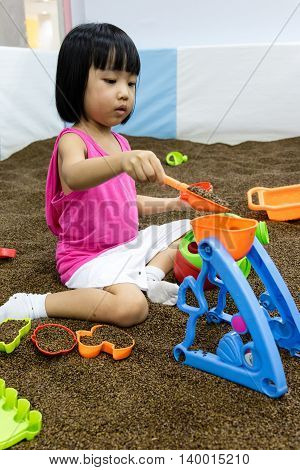 Asian Chinese Little Girl Playing With Sand