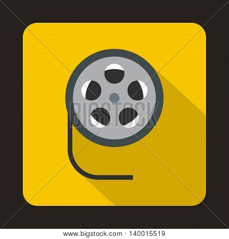 Film reel icon in flat style on a yellow background