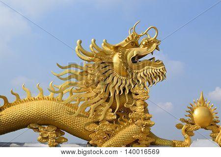 two big statue of golden dragon at Buddhist Chau Thoi temple Binh Duong Vietnam