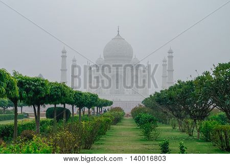Taj Mahal View In Morning Fog From Across The Mehtab Bagh Or The Moonlight Garden, Agra, India