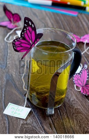 Background Decoration Paper Butterflies In A Glass Of Mint Tea. Peppermint Tea, Cardboard, Colored P