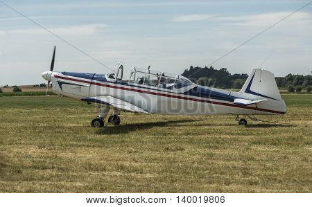 Towing aircraft on a grassy airport ready for takeoff. ZlIn 226MS