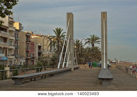 CALELLA SPAIN - JULY 11 2013: Footbridge in the center of Calella evening. City on the Costa Brava - a popular holiday destination of tourists from all European countries