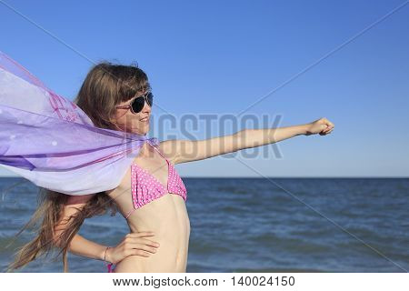 Girl on summer vacation on the beach.