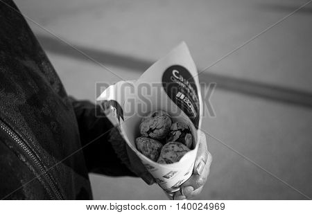 A roasted chestnut seller during winter time