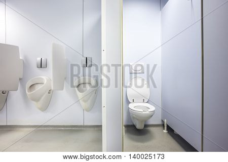 urinals and toilet in an old building for men only