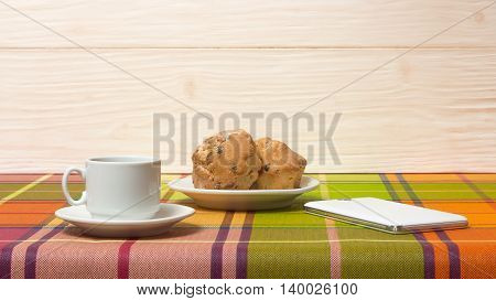 Coffee Cup muffins smartphone on the table
