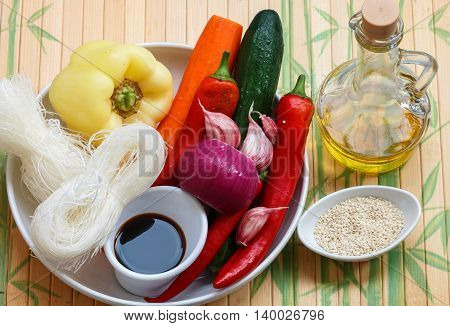 Ingredients for making spicy glass noodles with vegetables - carrots cucumber peppers garlic. Asian and Oriental cuisine. Selective focus