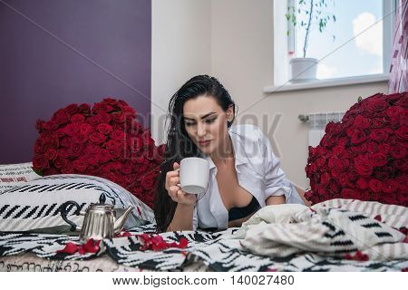 Girl Drinking Tea In Bed