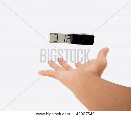 Time control: A clock floating in air above a hand isolated on white background