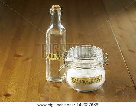 jar of baking soda and vinegar on the wooden background