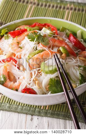 Thai Salad With Glass Noodles, Prawns And Vegetables Close-up. Vertical