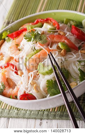 Thai Salad With Glass Noodles, Prawns And Peanuts Close-up. Vertical