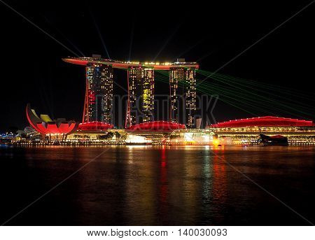 Night of the Marina Bay.  Singapore - June 05, 2016 Illuminated at night, office buildings and a vantage point Gardens by the Bay Marina on the Bay in Singapore